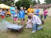 reg-laursen-helps-children-roast-marshmallows